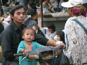 Dad & son on the bike at the Battambang market